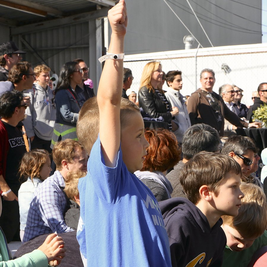 Fans cheer on Tony and the demo crew. Photo: Colin Vincent