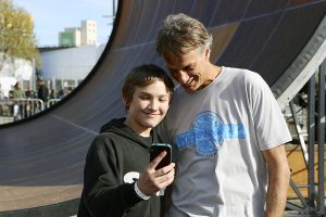 Tony Hawk and a fan shoot a selfie ramp-side. Photo: Colin Vincent